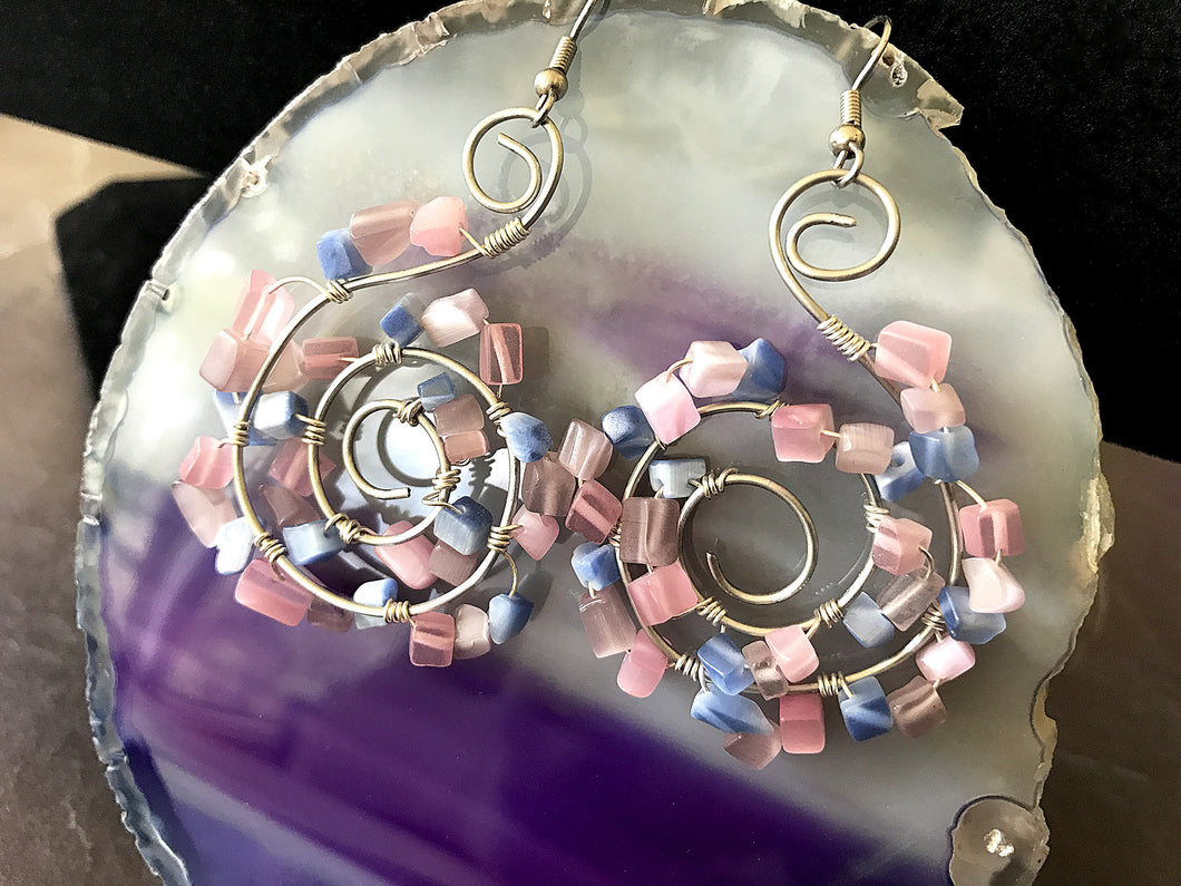 silver wire-wrapped swirl dangle earrings with pink and blue stone beads
