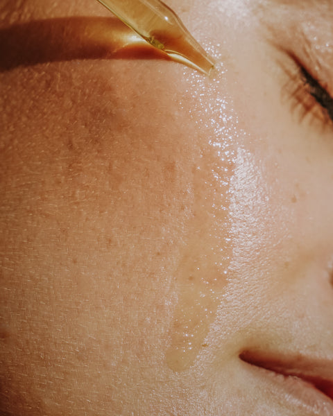 Woman With Face Oil Dripping Onto Face
