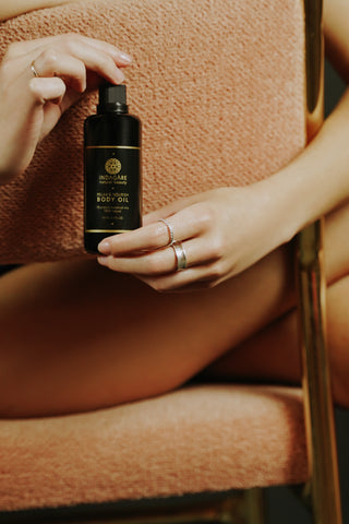 Indagare's Body Oil - Woman Sitting in Chair