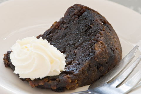 Slice of Christmas Pudding with cream