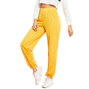 Women Yellow Elastic Waist Solid Loose Tapered Carrot Pants (wo1)