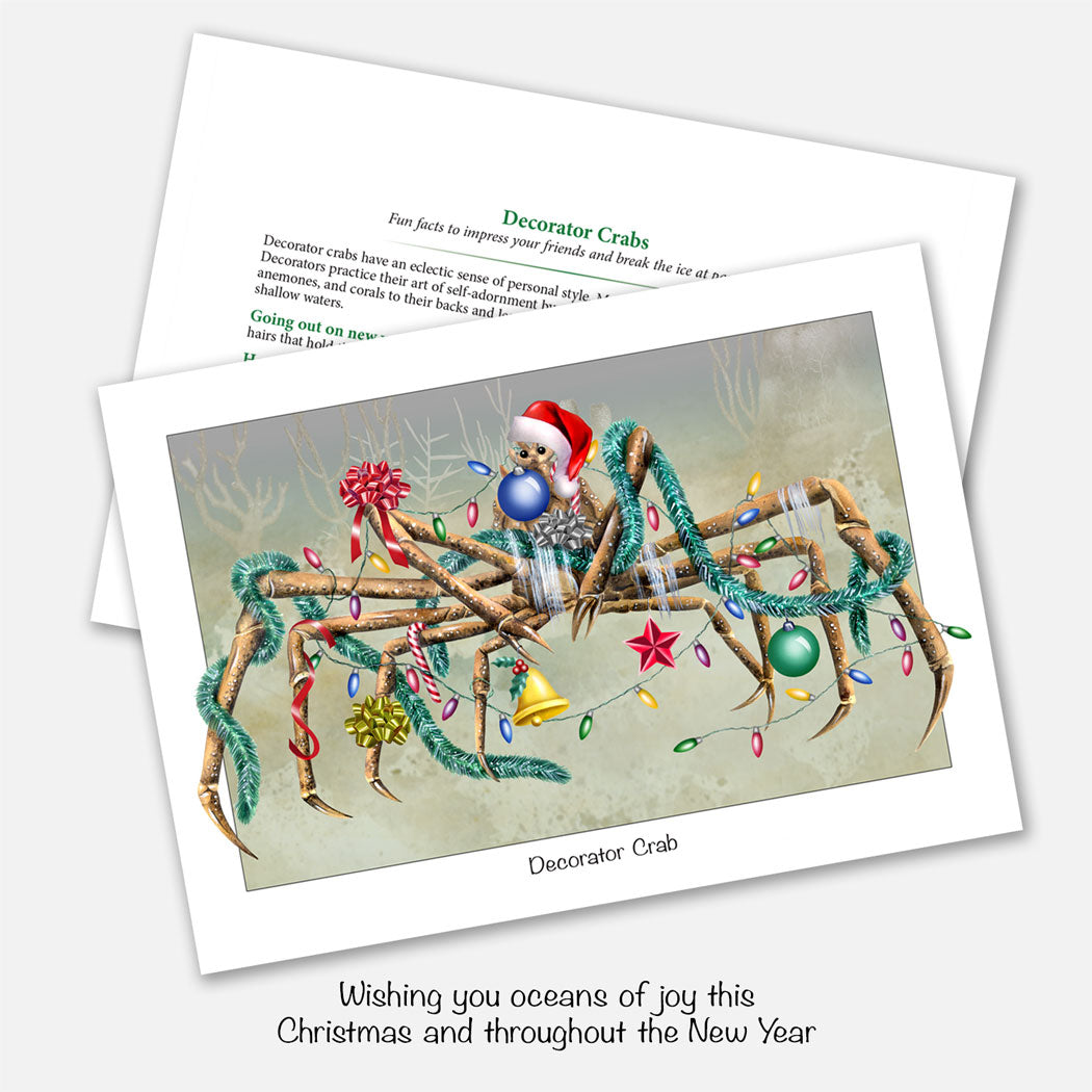 The card's image is of decorator crab (a real species of crab) decorated with Christmas ornaments.  Inside text: Wishing you oceans of joy this Christmas and throughout the New Year