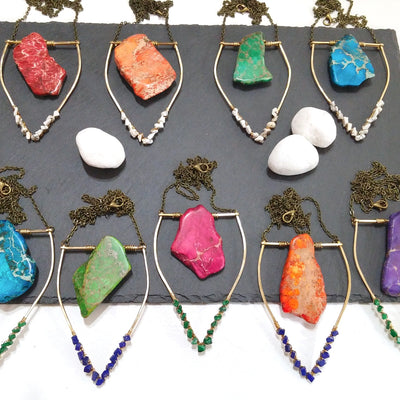 Handmade brass jewelry featuring a bold geometric design. Colorful jasper gemstone necklaces with howlite, malachite, and lapis lazuli gemstones.