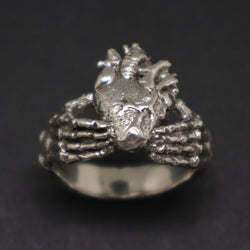 Skull Hand Holding Heart Claddagh Ring