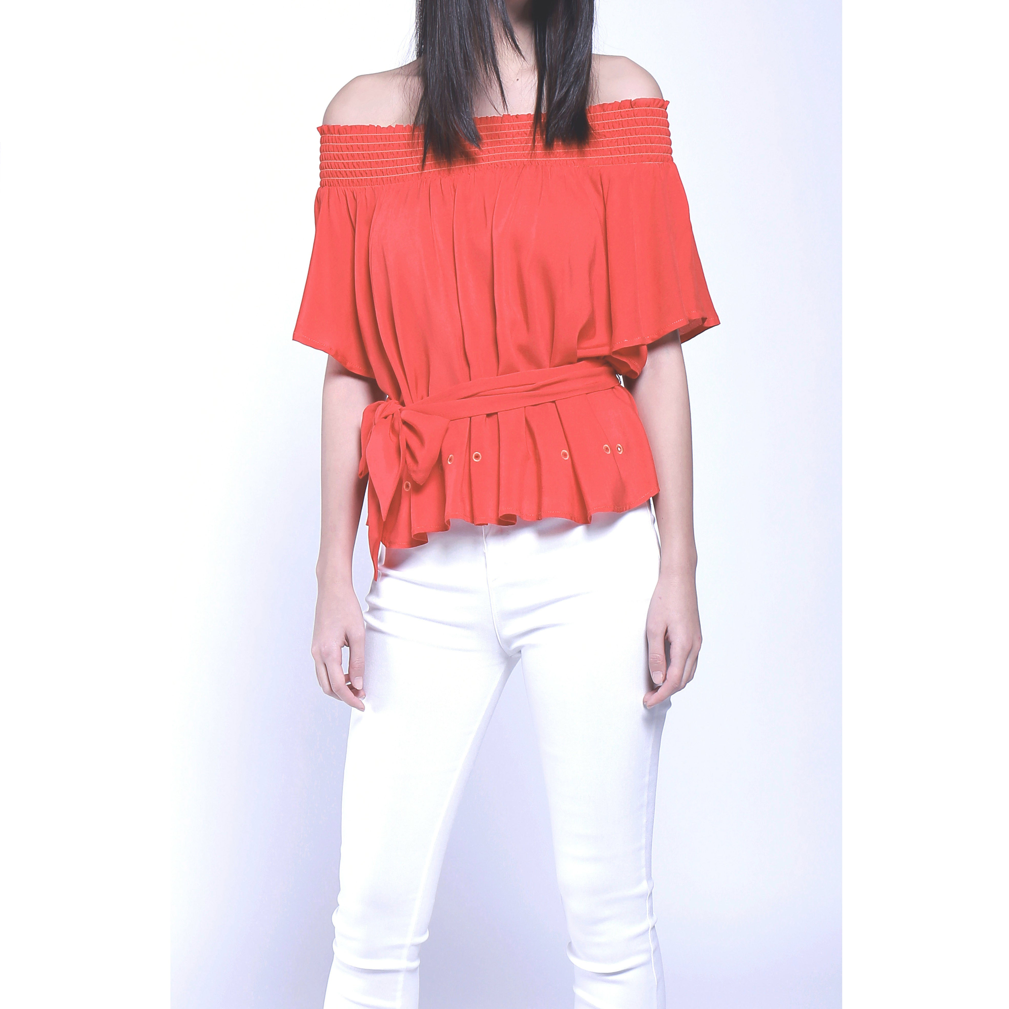 Flared sleeve off shoulder soft fabric top with tie belt & floral brooch - coral red
