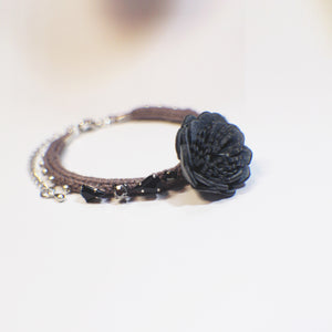 A flower hand-woven brown bracelet with sparkling beadings - customizable