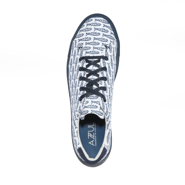 The Braga <br/>White Canvas <br/>Navy Embroidery <br/>Navy Sole