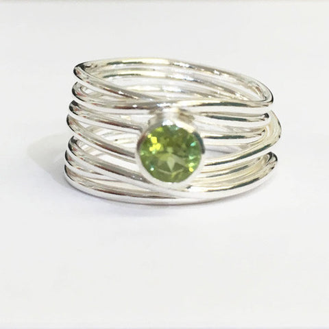 Abby Filer - Peridot 7 Strand Wrap Ring