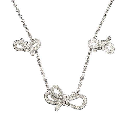 SWAROVSKI LIFELONG WHITE BOW SET IN RHODIUM PLATED