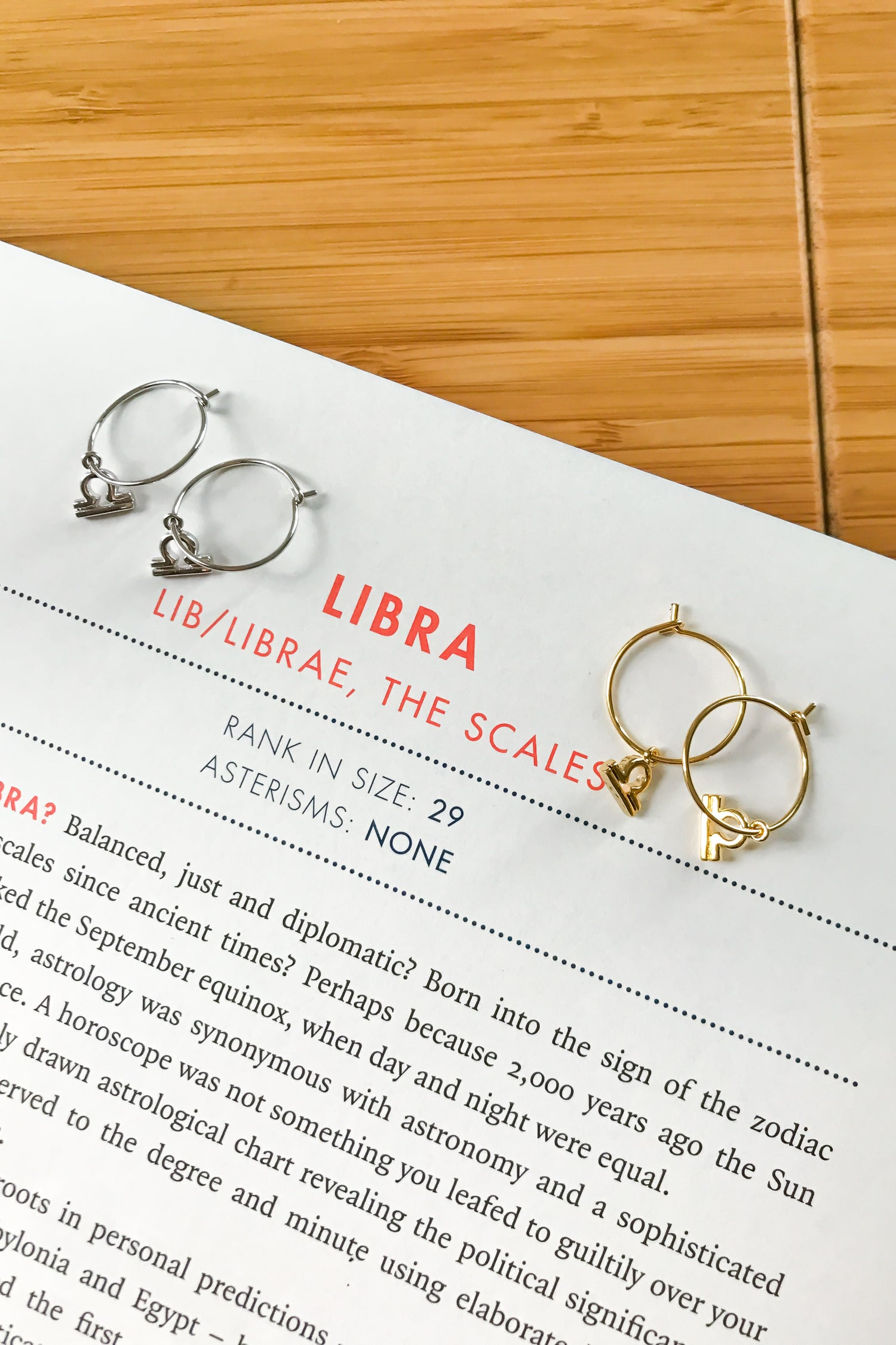 Libra mini hoop earrings