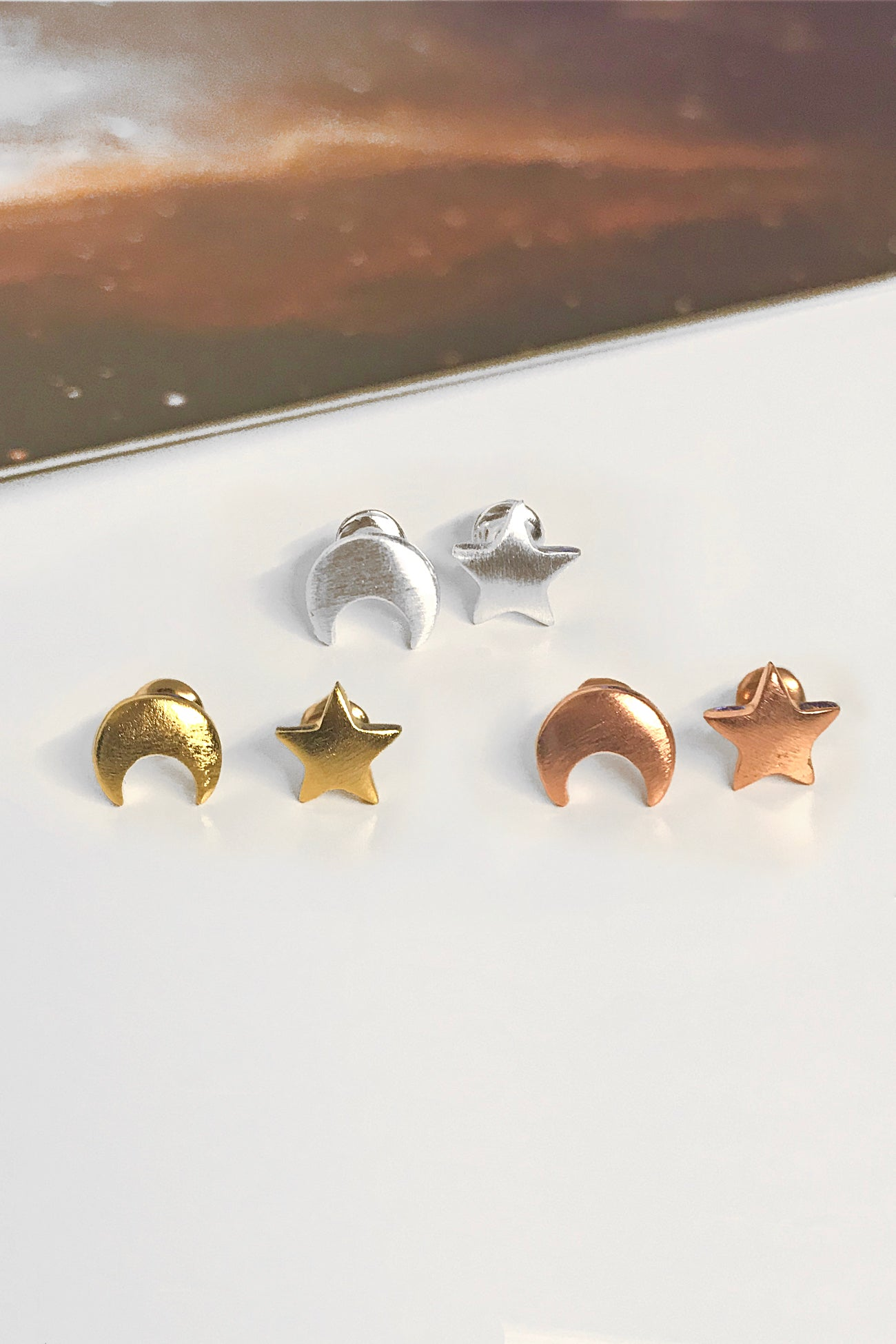 Mismatched moon/star stud earrings