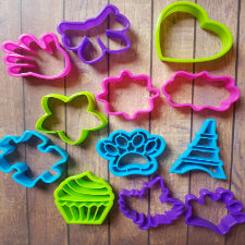 12pc Variety plastic cutters, Paw 5x4.3cm, Eiffel tower 4x5.5cm, Puzzle 5.5x4.5