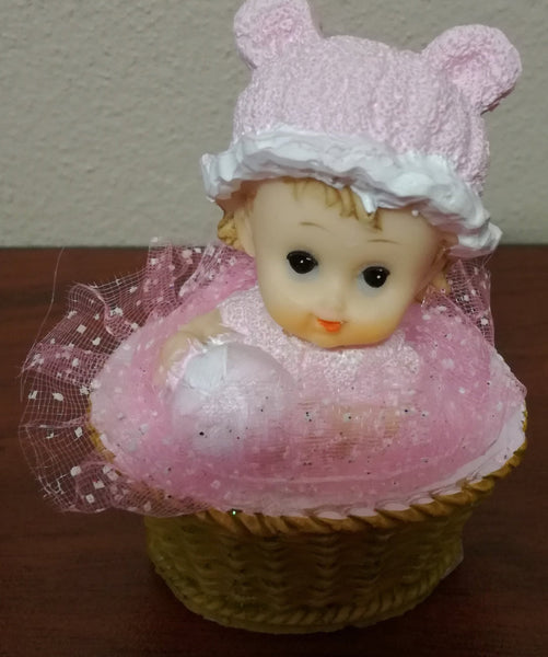 Baby girl in basket resin figurine 8x6cm