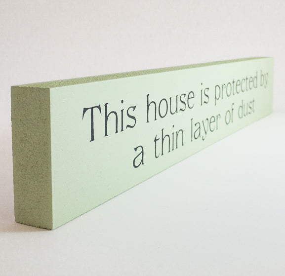 Sill Sitter - This house is protected by a thin layer of dust - Green