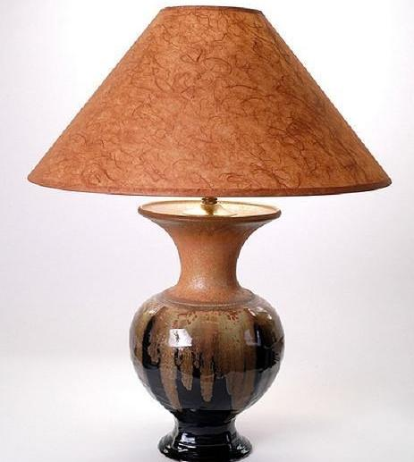 "A black ceramic lamp measuring 9"" wide and 22"" tall."