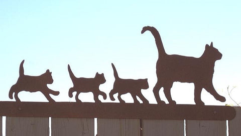 Metal sculpture of a cat family