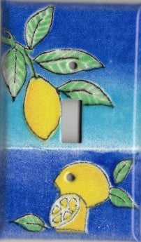 A handmade single toggle fused glass switch plate cover with the image of lemons.