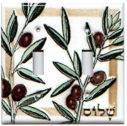 A handmade double toggle fused glass switch plate cover with the image of olive branches.