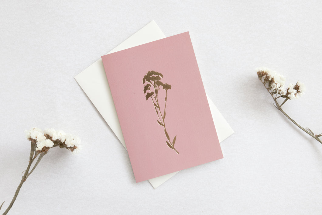 Foil blocked Alyssum card by Ola.  From the botanical collection, this rose pink card features a delicate floral brass Alyssum, with a caption detailing the meaning & origin of the flower on the reverse.   Perfect for many occasions including weddings, birthdays & christenings, when an additional touch of sentiment is required.  Single cards are cello wrapped and packaged with a luxury ivory envelope.   Traditionally foil blocked and printed by hand in the UK  300gsm paper stock  Ivory paper envelope  A6 si