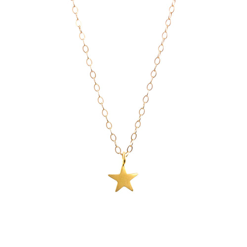 Gold tiny star necklace by Lily King
