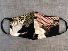 A art deco face mask in Japanese inspired fabric with crane birds
