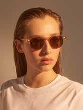 Model wears Champagne Marvin sunglasses by A.Kjaerbed