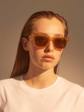 Model wears Nancy sunglasses in Light Brown Transparent by A.Kjaerbede