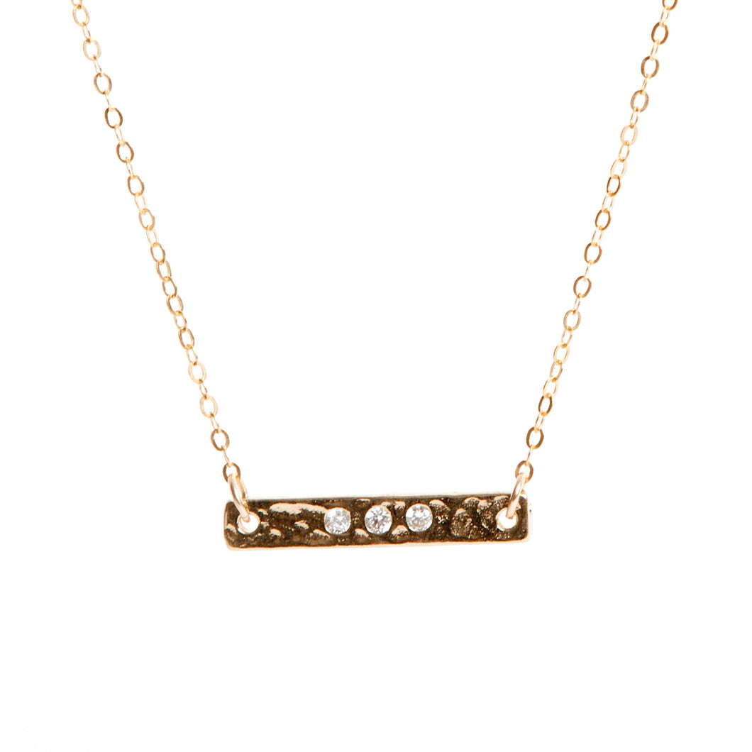 Lily King - 18k Gold Vermeil hammered cubic zirconia bar charm, attached to 14k Gold Filled cable chain. Fastens with a spring clasp.