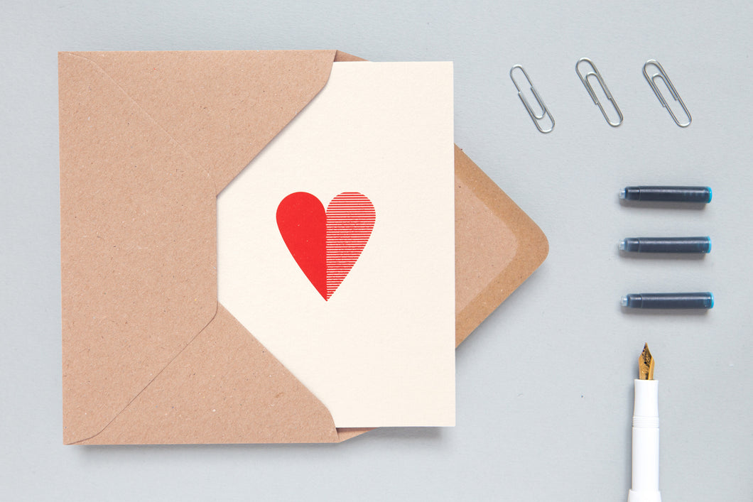 Foil blocked heart card by Ola.  Distinctive and contemporary heart card in vibrant red on stone.  Traditionally foil blocked on quality textured paper - perfect for a loved one!  Made in the UK  270gsm paper stock  Kraft paper envelope  A6 size  Left blank inside for your own message