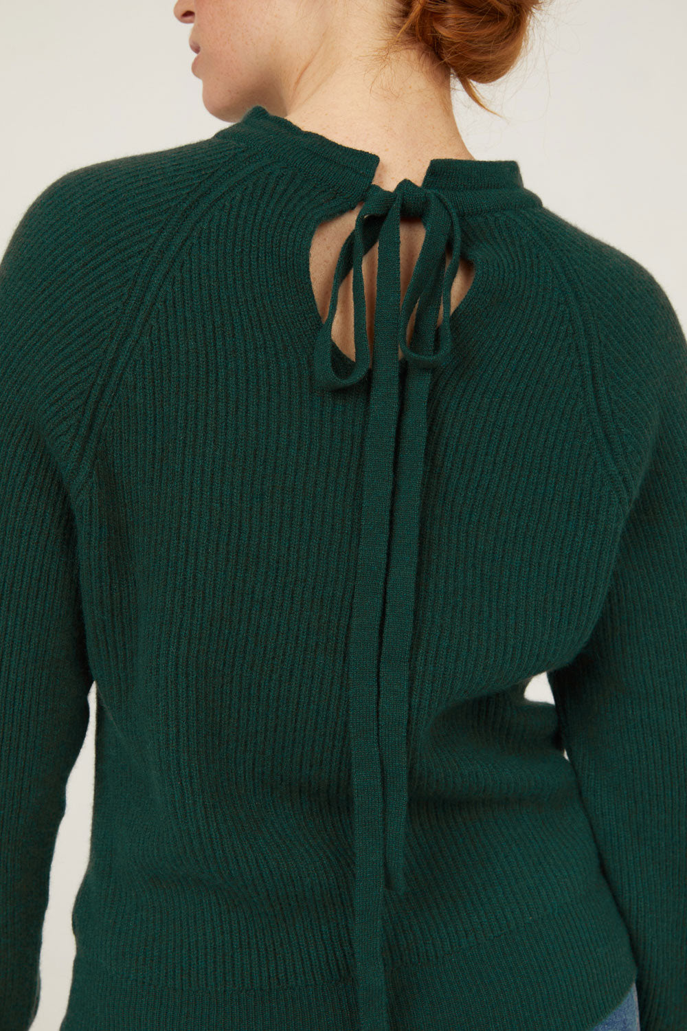 Evergreen cashmere mock neck pullover sweater with tie back bow detail