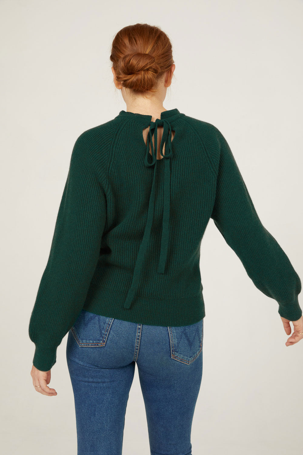 Evergreen cashmere mock neck pullover sweater with tie back back detail
