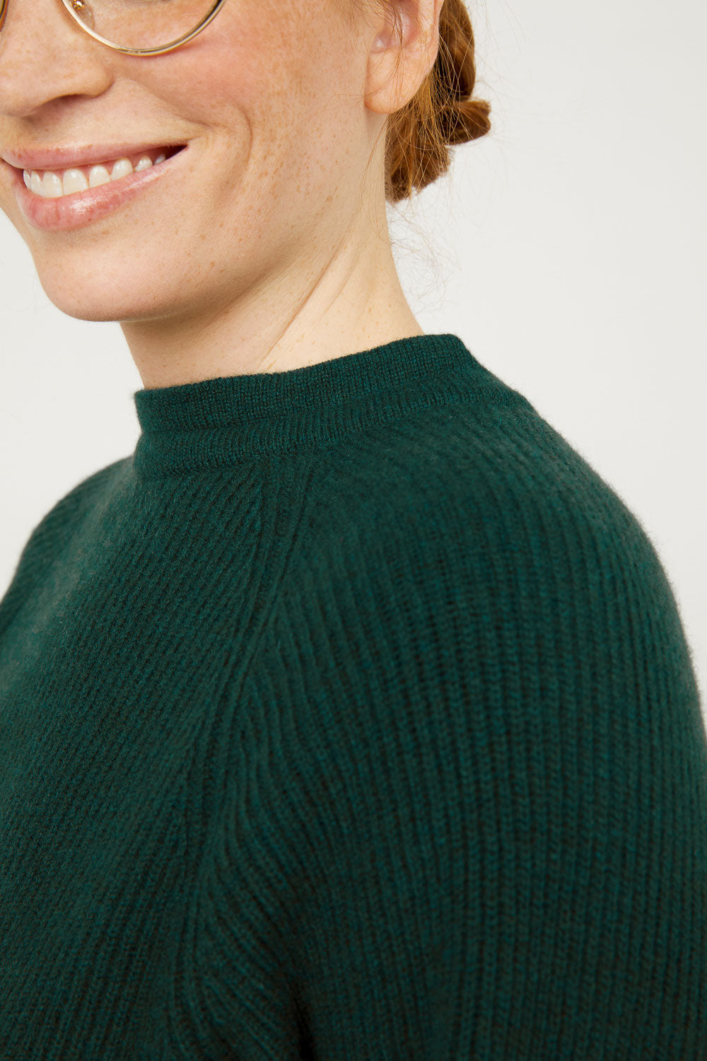 Evergreen cashmere mock neck pullover sweater with tie back neck detail