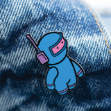 Spaceman enamel pin on Jean Jacket