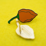 Spicy Habanero Front and Back of Lapel Pin on Yellow Felt