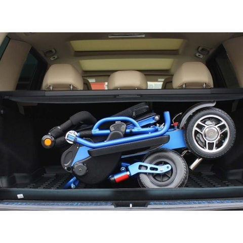 Pathway Mobility Geo Cruiser DX Folding Power Wheelchair Blue Folded in Trunk View