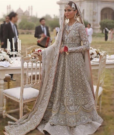 Best Walima Dulhan Lahnga In Light Gray And Pink Color.Work Embalished With Dabka Zari Nagh And Sequance Work In Beutifull Maxi And Farshi Lahnga Style.