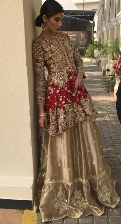 Beutifull bridal lahnga in maroon red and golden color Model # B 911