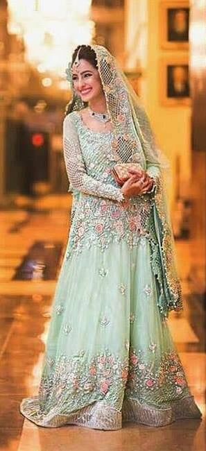 Bridal maxi in mint green color with heavy dabka threds crystals pearls nagh and cutwork Model#B1005