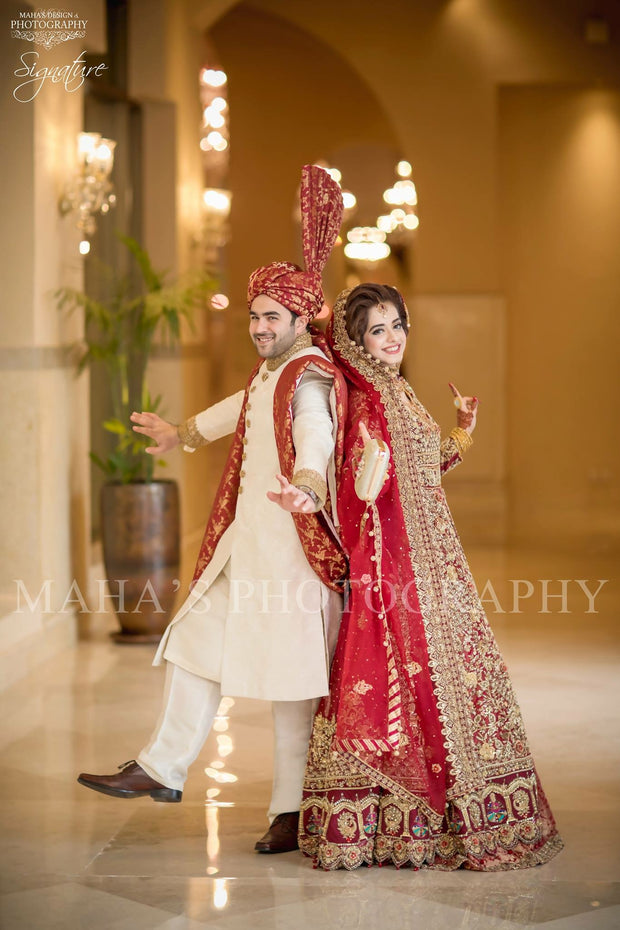 Beautiful bridal dress in red color Side Pose