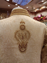 Dulha Sherwani With Turban In Beautiful Golden Color.Work Embellished With Maroon Nagh,Dabka,Zari,And Zardozi Work.
