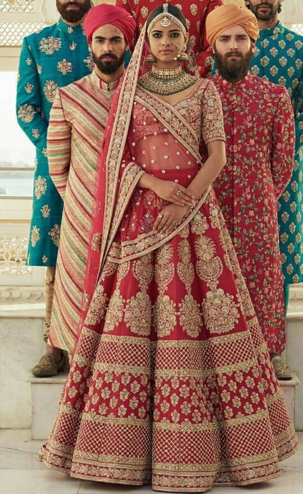 Sabyasachi Bridal Dress in Hot Red Color.Work Embalished With Threads Embroidery Dabka Zari,And Zardozi Work.