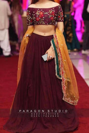 Indian Lahnga Choli In Dark Maroon Color.Work Embellished With Pure Threads Embroidery And Gota Work On Dupata.