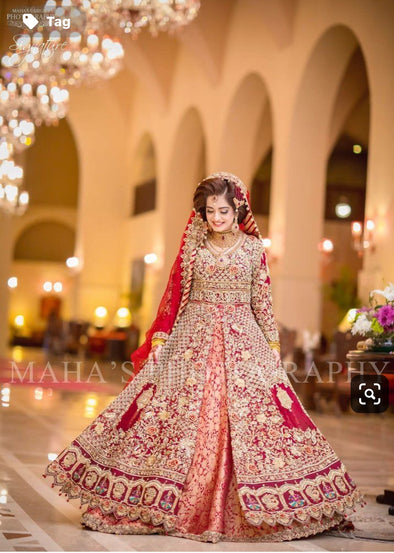 Pakistani Dulhan Maxi In Beutifull Hot Red Color.Work Embellished With Pure Dull Gold Dabka,Zari,Naqshi,Sequance,Pearls And Moti Work.