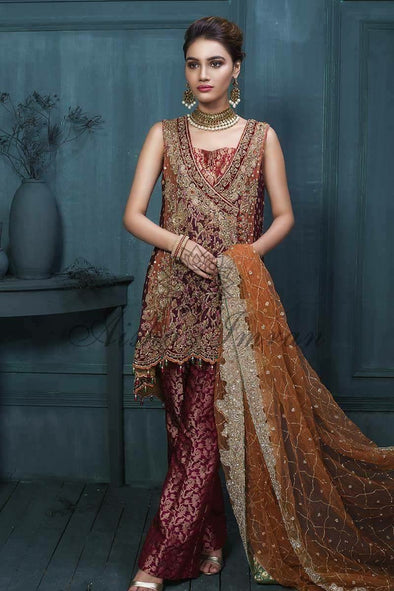 Beutifull bridal dress in maroon and copper color in paplam style with heavy dabka threds nagh crystals and gota work Model#P 1006