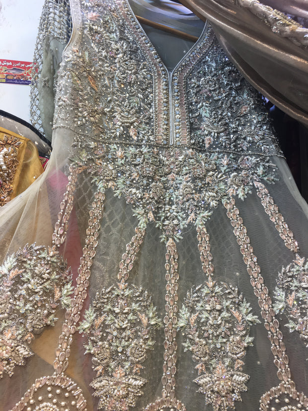 Heavy Wedding Dress In Beutiful Pinkish Gray Color.Work Embellished With Pure Dabka Crystals Nagh,Pearls Moti & Sequance Work. In Beutiful Paplam Style. This Style Can B Custumized In Any Type Of Shirt Shape. (B,,T, Zar,)
