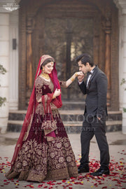 Bridal Reception Lahnga In Dark Maroon Color.Work Embalished With Pure Dabka Zari Sequance And Stone Work.