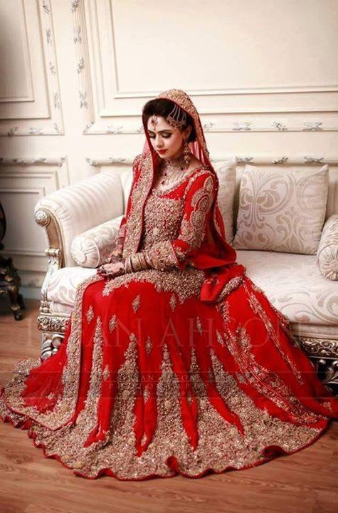 Bridal lahnga in red color with heavy dabka loaf work with crystal perls and nagh work Model#B1003