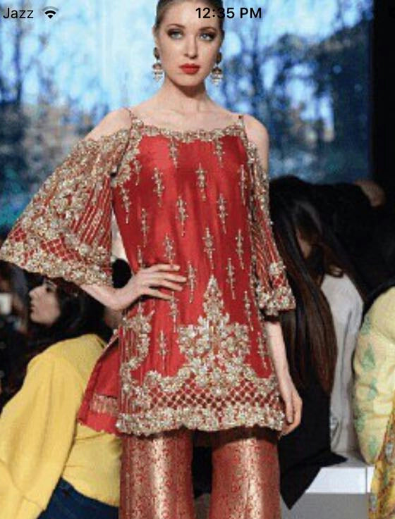 Pakistani Dulhan Suit In Beautiful Maroon Color.Work Embalished With Dull Golden Dabka ,Nagh,Zari,Stone And Pearls.