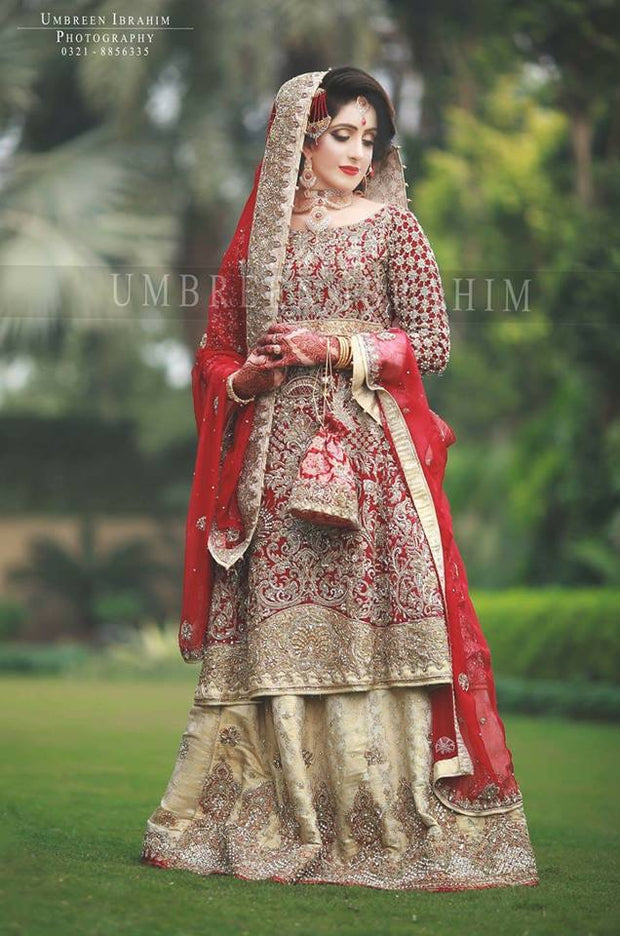 Beautiful bridal lahnga in rose red and golden color