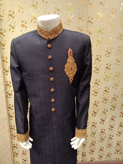 Latest Sherwani In Blue Jamawar Fabric.work Embellished With Ban,Cuff And Buttons With Pure Dabka,Zari,Zardozi & Stone Work.
